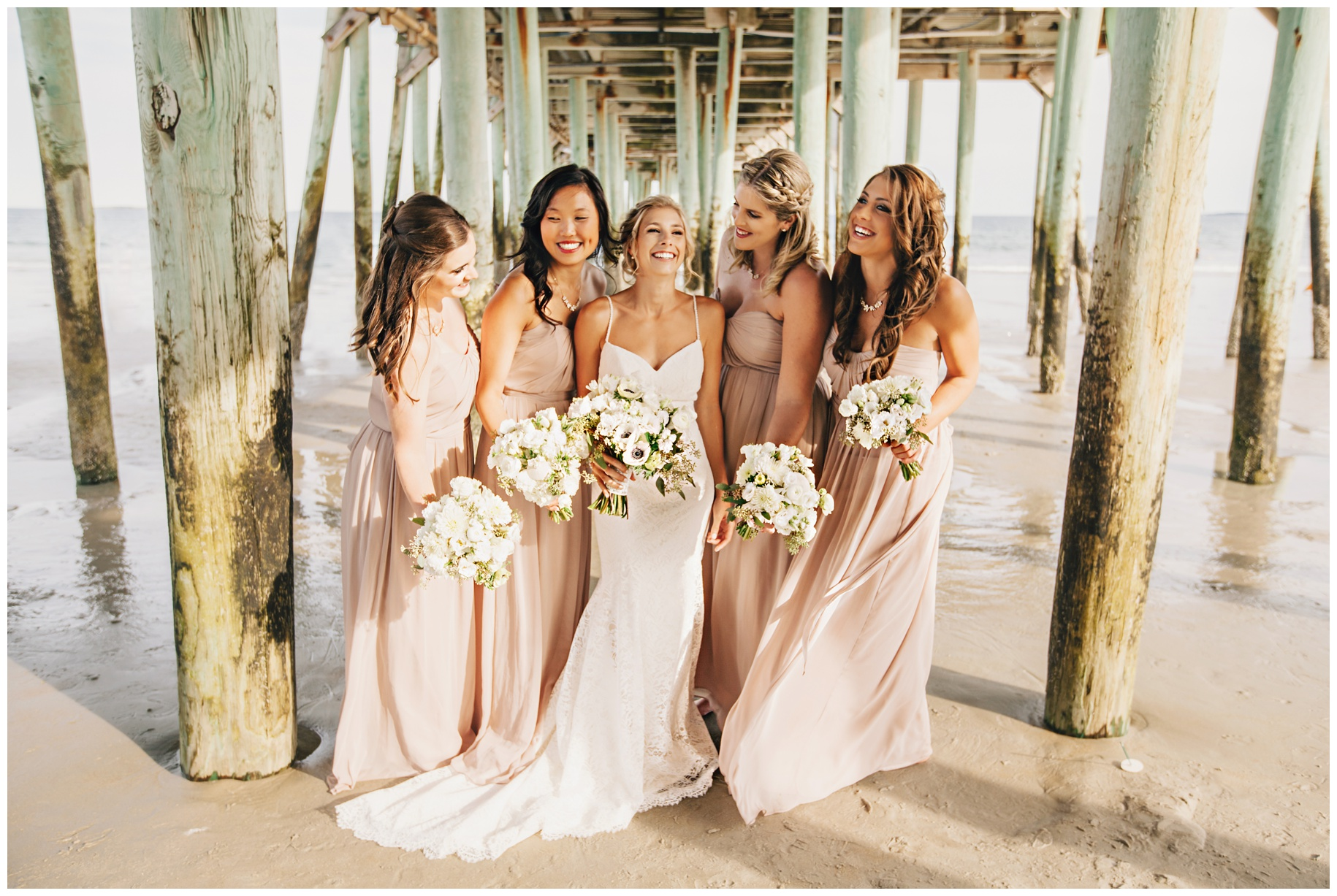 MaineWeddingPhotographer_OldOrchard_Beach_Coast_pier_tent-011
